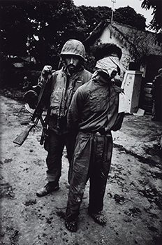US Marine with a Captured North Vietnamese Soldier, The Battle of Hue 1968, printed 2013 by Don McCullin born 1935
