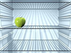 Fresh Green Apple in an empty fridge